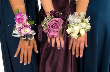 Girls hands wearing corsages for prom