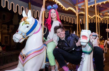 Halsey and Yungblud ride a carousel at Disney