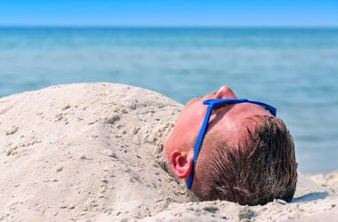 Guy Buried in the sand