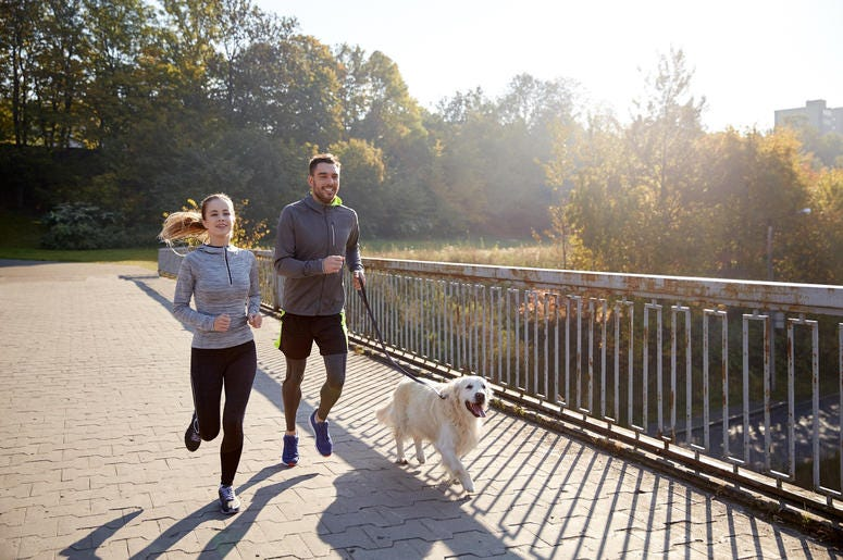 people Jogging With Their Dog