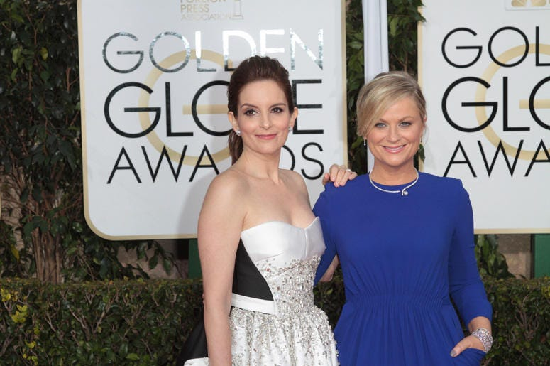Actress and Co-Host Tina Fey and Amy Poehler arrive at the 72nd Annual Golden Globe Awards
