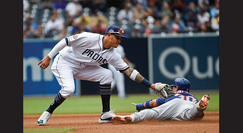 Michael Conforto #30 of the New York Mets steals second base ahead of the tag of Manny Machado #13 of the San Diego Padres during the seventh inning of a baseball game at Petco Park May 8, 2019 in San Diego, California. (Photo by Denis Poroy/Getty Images)