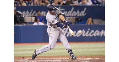 Hunter Renfroe #10 of the San Diego Padres hits a single in the fifth inning during MLB game action against the Toronto Blue Jays at Rogers Centre on May 25, 2019 in Toronto, Canada. (Photo by Tom Szczerbowski/Getty Images)