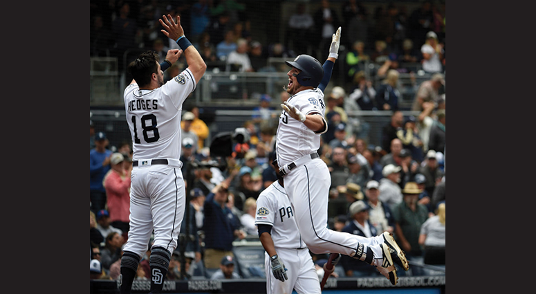 Hunter Renfroe #10 of the San Diego Padres is congratulated by Austin Hedges #18 after hitting a solo home run during the seventh inning of a baseball game against the New York Mets at Petco Park May 8, 2019 in San Diego, California. (Photo by Denis Poroy