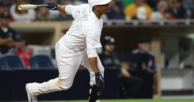 SAN DIEGO, CALIFORNIA - AUGUST 23: Francisco Mejia #27 of the San Diego Padres at bat during a game against the Boston Red Sox at PETCO Park on August 23, 2019 in San Diego, California. Teams are wearing special color schemed uniforms with players choosin