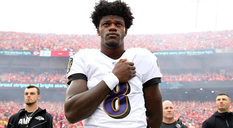 EPTEMBER 22: Quarterback Lamar Jackson #8 of the Baltimore Ravens stands during the national anthem before their game against the Kansas City Chiefs at Arrowhead Stadium on September 22, 2019 in Kansas City, Missouri. (Photo by Jamie Squire/Getty Images)