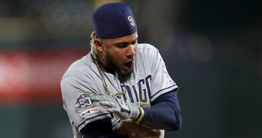 JUNE 14: Fernando Tatis Jr #23 of the San Diego Padres celebrates after hitting a triple in the 12th inning against the Colorado Rockies at Coors Field on June 14, 2019 in Denver, Colorado. (Photo by Matthew Stockman/Getty Images)