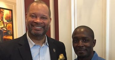 Nevada Attorney General Aaron Ford with wrongly convicted man Demarlo Barry