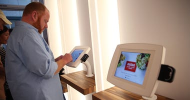 A customer uses an interactive kiosk to place orders at eatsa, a fully automated fast food restaurant on August 31, 2015 in San Francisco, California.