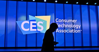 n attendee walks by the stage prior to a Samsung press event for CES 2020 at the Mandalay Bay Convention Center on January 6, 2020