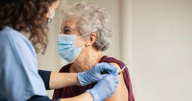 Elderly woman receiving her coronavirus vaccine