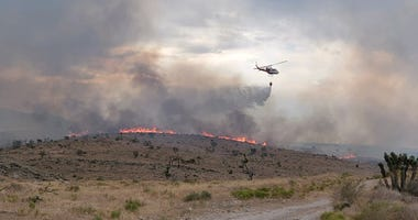 Crews work to put out the Cottonwood Fire burning near Goodsprings on 7-20-20