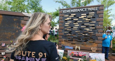 A guest visits the Las Vegas Community Healing Garden's remembrance wall on October 1, 2018 in Las Vegas, Nevada.