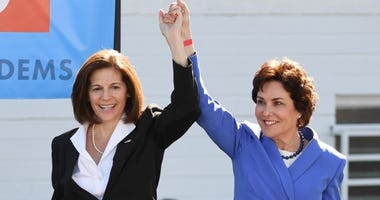 U.S. Sen. Catherine Cortez Masto (D-NV) (L) introduces U.S. Rep. and U.S. Senate candidate Jacky Rosen (D-NV) during a rally at the Culinary Workers Union Hall Local 226 featuring former U.S. Vice President Joe Biden on October 20, 2018
