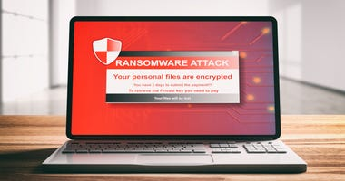 Ransomware, virus attack alert on a computer laptop screen, wooden desk, blur office background, front view. 3d illustration