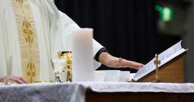 Detail of a catholic priest serving mass at a liturgy.