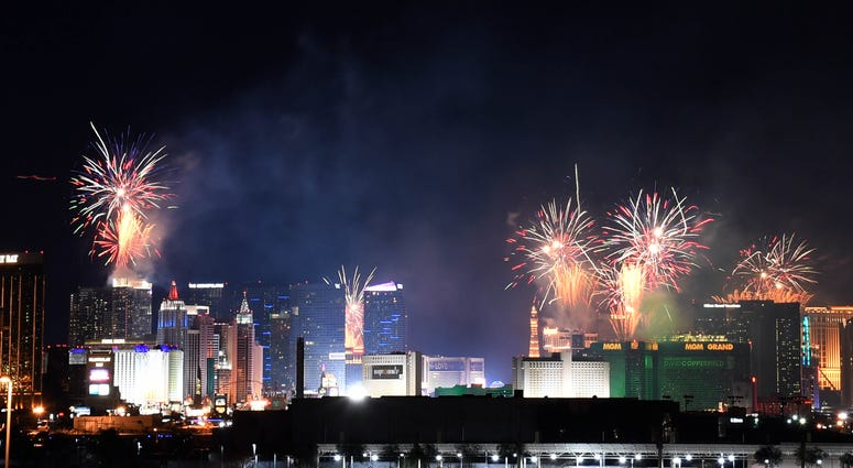 "Fireworks illuminate the skyline over the Las Vegas Strip during an 8-minute-long pyrotechnics show put on by Fireworks by Grucci titled ""America's Party"" during a New Year's Eve celebration on January 1, 2019"
