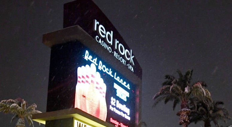 Snow falls outside the Red Rock Casino during a winter storm on February 20, 2019 in Las Vegas, Nevada.
