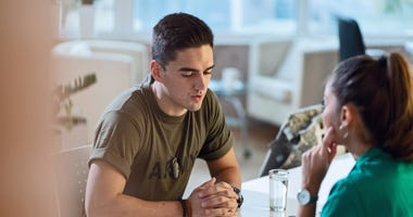 Young military officer having an appointment with psychotherapist at doctor's office