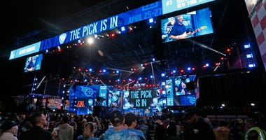 Hometown fans of the Tennessee Titans react after their first round pick of Jeffery Simmons is announced on day 1 of the 2019 NFL Draft on April 25, 2019 in Nashville, Tennessee
