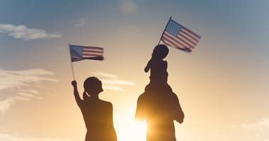 Family waving American flags