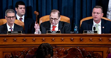 U.S. House Judiciary Committee Chairman Jerry Nadler (D-NY) (C) gavels to an adjournment the committee hearing on the articles of impeachment against President Donald Trump as ranking member Doug Collins (R-GA) (R) looks on at the Longworth House Office