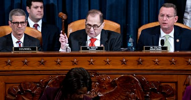 U.S. House Judiciary Committee Chairman Jerry Nadler (D-NY) (C) gavels to an adjournment the committee hearing on the articles of impeachment against President Donald Trump as ranking member Doug Collins (R-GA) (R) looks on.