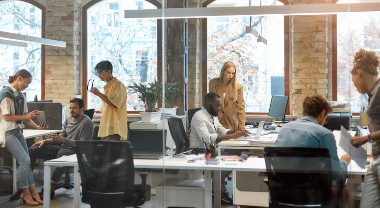 Group of young mixed race business people working together in the creative office.