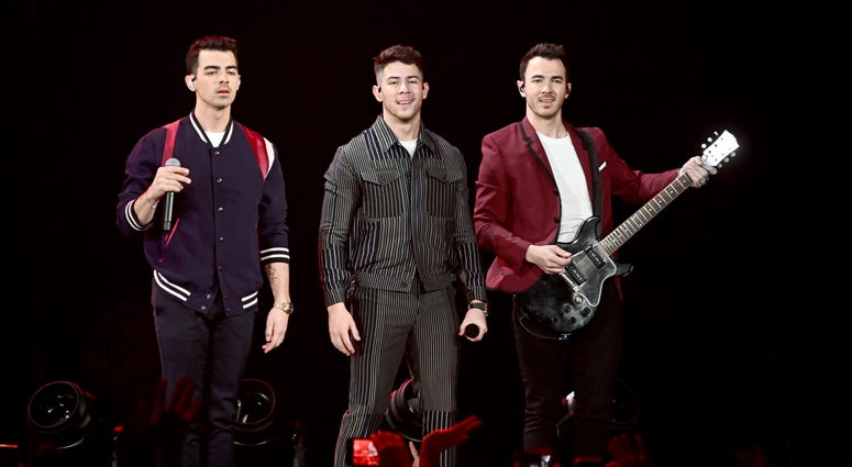Nick Jonas, Joe Jonas, Kevin Jonas of the Jonas Brothers perform during 103.5 KISS FM's Jingle Ball 2019 - Show on December 18, 2019 in Chicago, Illinois.