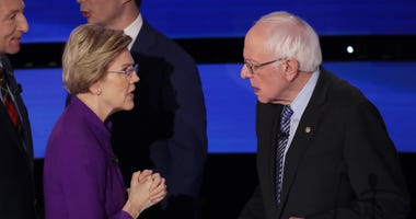 Sen. Elizabeth Warren (D-MA) and Sen. Bernie Sanders (I-VT) speak after the Democratic presidential primary debate at Drake University on January 14, 2020 in Des Moines, Iowa.