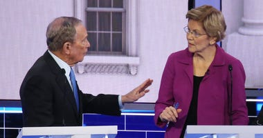Democratic presidential candidates former New York City Mayor Mike Bloomberg and Sen. Elizabeth Warren (D-MA) speak during the Democratic presidential primary debate at Paris Las Vegas on February 19, 2020 in Las Vegas,