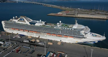 Passengers disembark from the Princess Cruises Grand Princess cruise as it sits docked in the Port of Oakland on March 10, 2020 in Oakland, California.