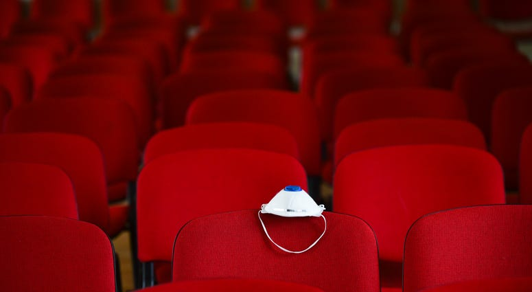 Movie theater with face covering for coronavirus protection