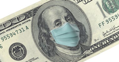 American One Hundred Dollar Bill with surgical mask. Protection from Coronavirus on economy.