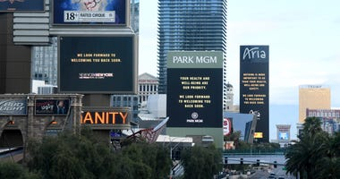 The marquees at the New York-New York Hotel & Casino, Park MGM and the Aria Resort & Casino display messages after the Las Vegas Strip resorts were closed as the coronavirus continues to spread across the United States on March 17, 2020