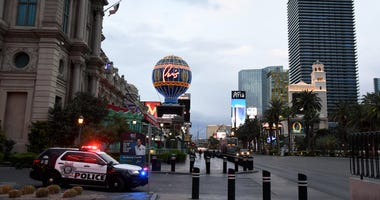 A Las Vegas Metropolitan Police Department vehicle is parked at Paris Las Vegas as parts of the Las Vegas Strip go dark as a result of the statewide shutdown due to the continued spread of coronavirus across the United States on March 19, 2020