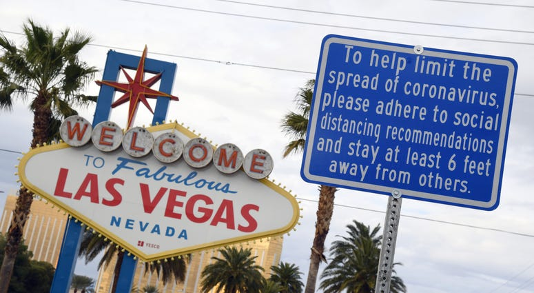 Welcome To Las Vegas Sign with social distancing rules