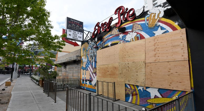 The closed Evel Pie restaurant in the Fremont East Entertainment District is boarded up as a result of the statewide shutdown due to the continuing spread of the coronavirus across the United States on March 22, 2020