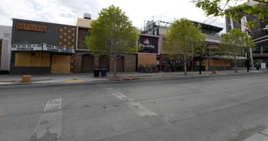Businesses in the Fremont East Entertainment District are shown boarded up as a result of the statewide shutdown due to the continuing spread of the coronavirus across the United States on March 22, 2020
