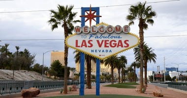 The area in front of the Welcome to Fabulous Las Vegas sign, where tourists often line up to take photos, is shown empty as most businesses in the area are closed as a result of the statewide shutdown due to the continuing spread of the coronavirus across