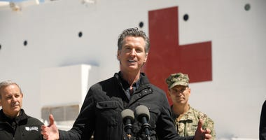 California Governor Gavin Newsom speaks in front of the hospital ship USNS Mercy that arrived into the Port of Los Angeles on Friday, March 27, 2020