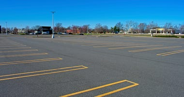 Empty parking lot in East Brunswick mall, New Jersey, USA, on Friday afternoon, March 27th, 2020, as a result of store closings due to the Covid 19,