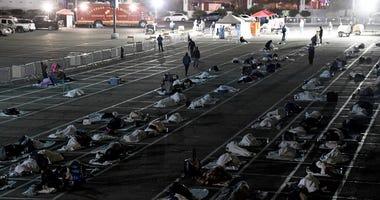 People are shown in social-distancing boxes at a temporary homeless shelter set up in a parking lot at Cashman Center on March 30, 2020 in Las Vegas, Nevada