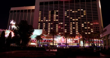 """An exterior view shows guest rooms at the shuttered Flamingo Las Vegas on the Las Vegas Strip illuminated to spell out a """"We love Vegas"""" message as a result of the statewide shutdown due to the continuing spread of the coronavirus across the United States"""