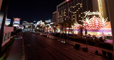 An exterior view shows a nearly empty Las Vegas Strip below guest rooms at the shuttered Flamingo Las Vegas