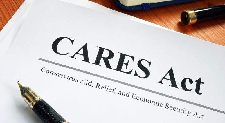 Coronavirus Aid, Relief, and Economic Security CARES Act on the desk