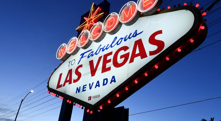 """ed lights flicker around the Welcome to Fabulous Las Vegas sign as part of a """"red takeover"""" coinciding with the 37th National Travel and Tourism Week (NTTW) amid the coronavirus pandemic on May 5, 2020 in Las Vegas"""