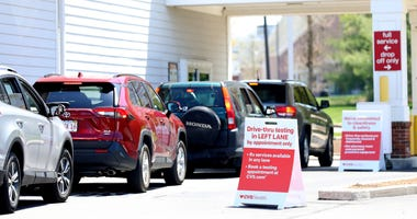 Cars line up for a drive-thru coronavirus (COVID-19) test at CVS Pharmacy on May 15, 2020 in Carver, Massachusetts.