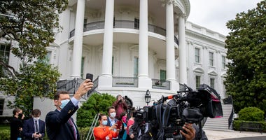 Journalists cover Marine One landing with President Trump on the south lawn of the White House on May 17, 2020 in Washington, DC