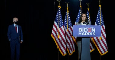 Presumptive Democratic presidential nominee former Vice President Joe Biden looks on as his running mate Sen. Kamala Harris (D-CA) delivers remarks following a coronavirus briefing with health experts at the Hotel DuPont on August 13, 2020